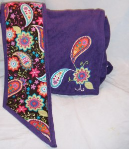 The applique on the front of this Onbag is inspired by the paisley pattern on the fabric....