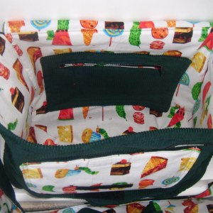 The inside of an Onbag Baby only has one pocket - and that is the zippered on at the back.