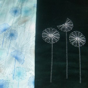 The dandelion embroidery matches the wild flowers in the fabric :)