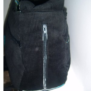 On one side is a waterproof, zippiered pocket to hold a water bottle ;)