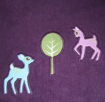 The deer are playing chase round the little tree in the fabric ;)