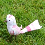 This quirky little bird measures approximately 10cm tall. She is made from a pattern by Ann Wood.